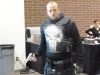 The Punisher checks out his weapon. Watch out, its loaded!